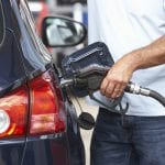 Detail Of Male Motorist Filling Car With Diesel At Petrol Station